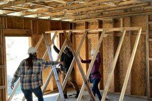 students raise interior wall
