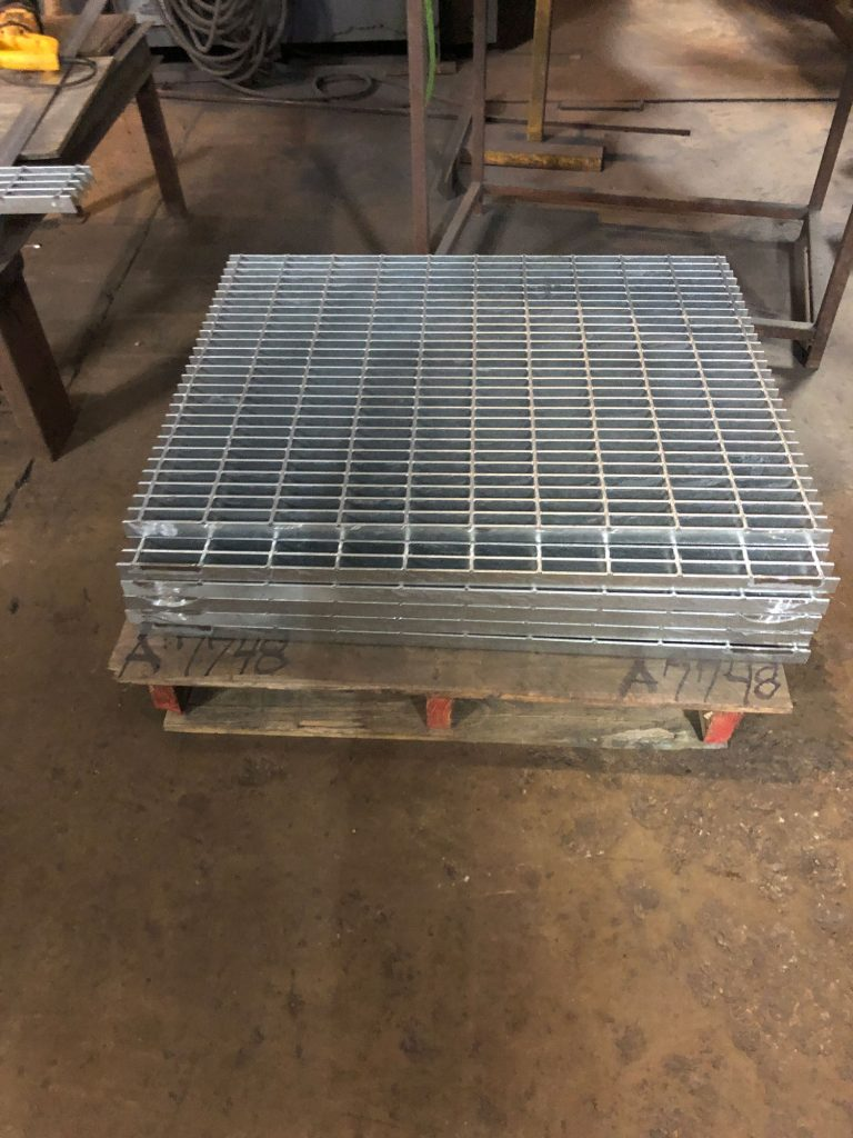 stacked, cut metal grate