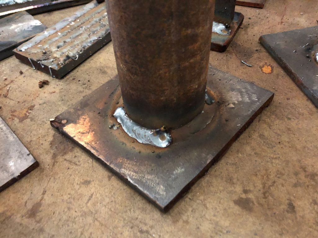 tube welded to base plate