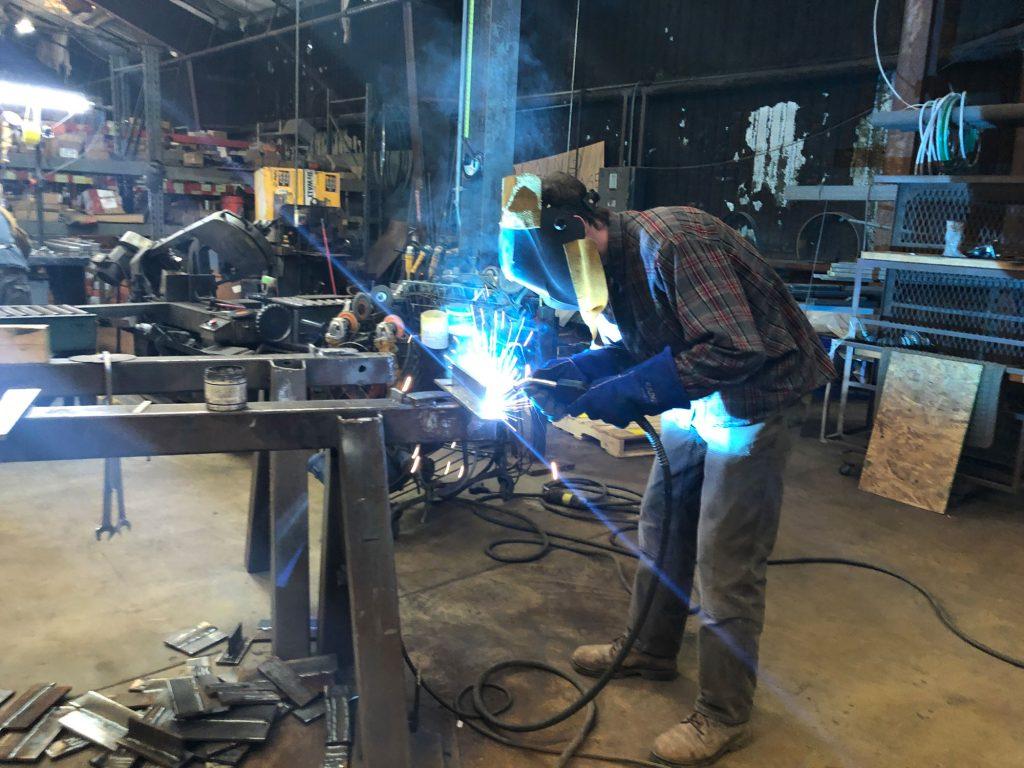 Rowe practice welding perpendicular metal plates