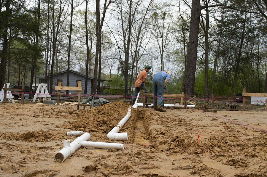 students dig plumbing trench