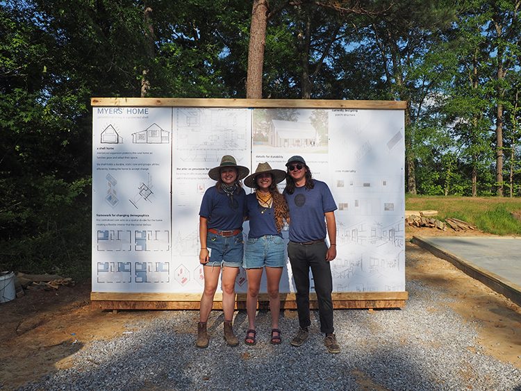 Myers' home team standing before their boards at Pig Roast