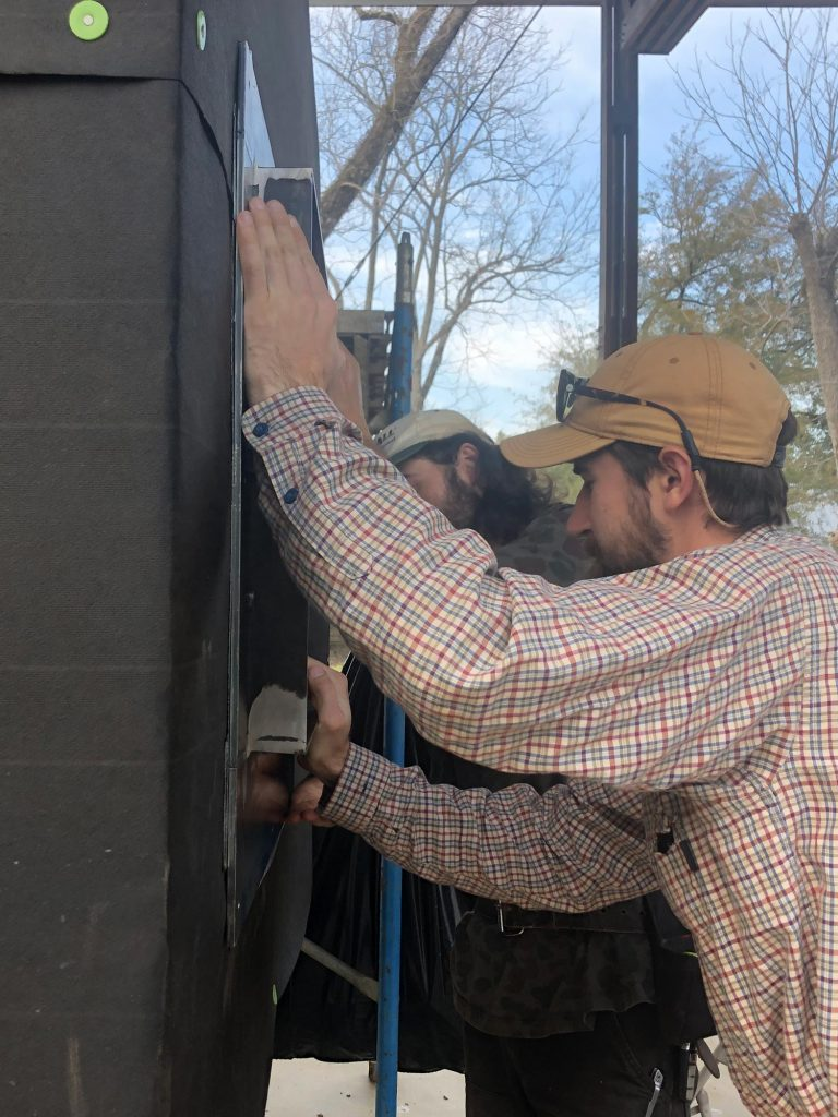 students inserting door frame to mock-up