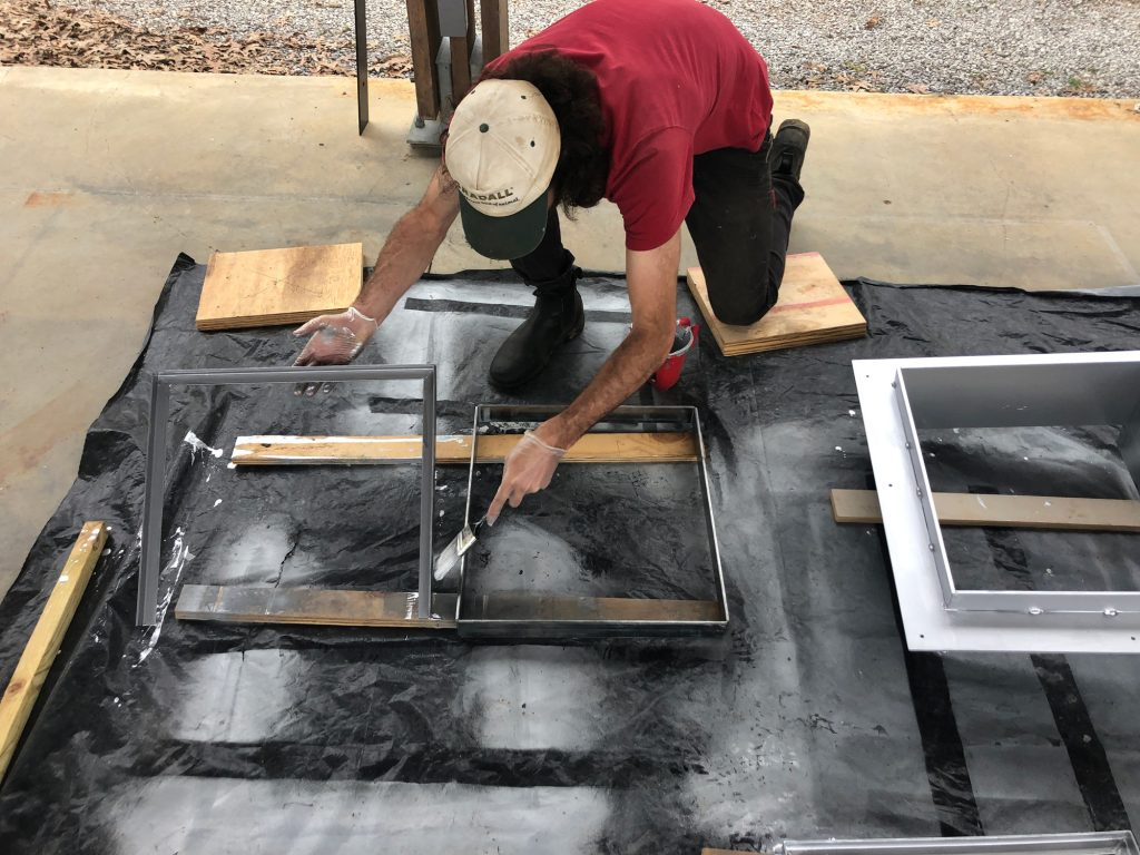 cory painting steel mock-up door frame with galvanizing paint