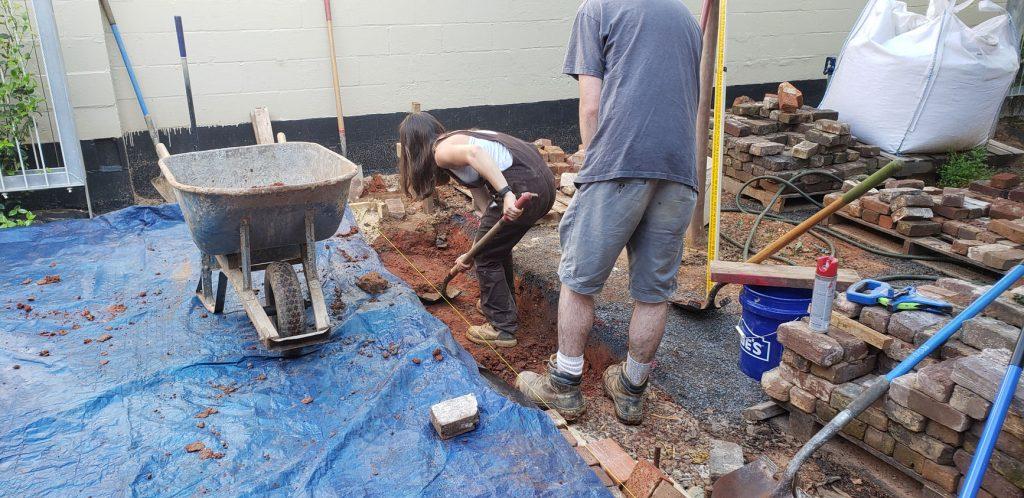 students digging footing