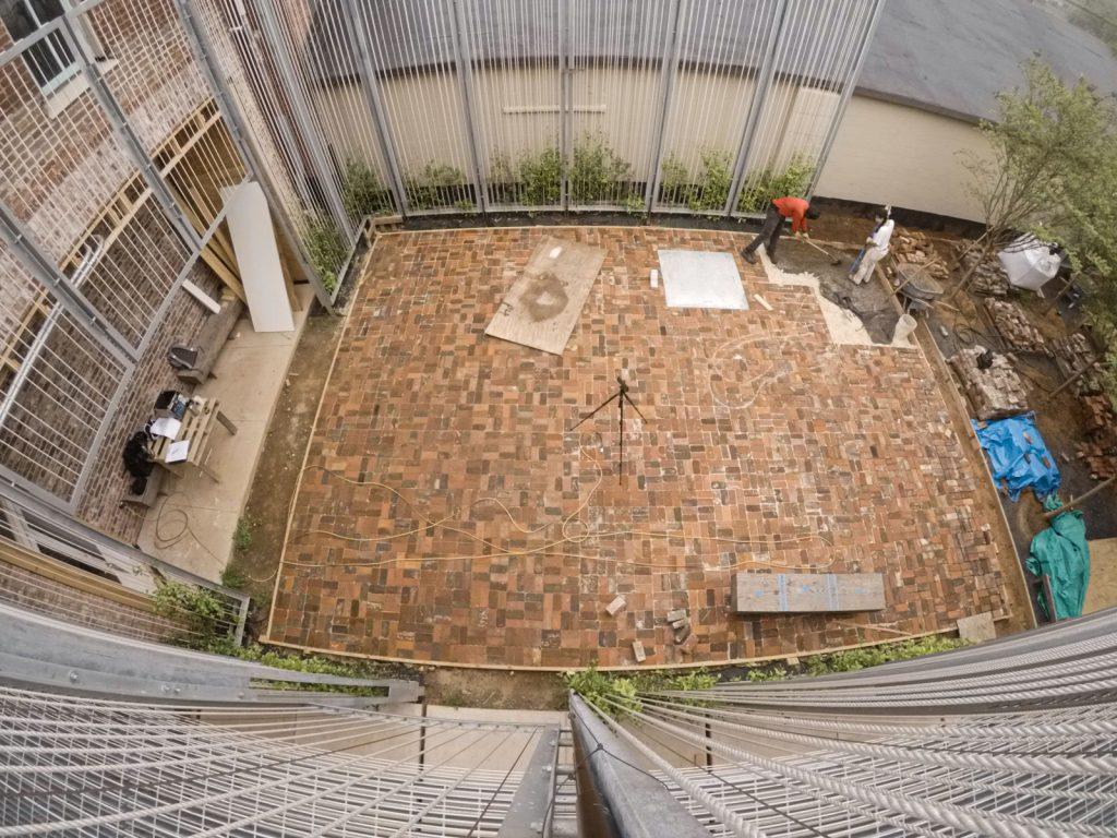 speading sand for bricks