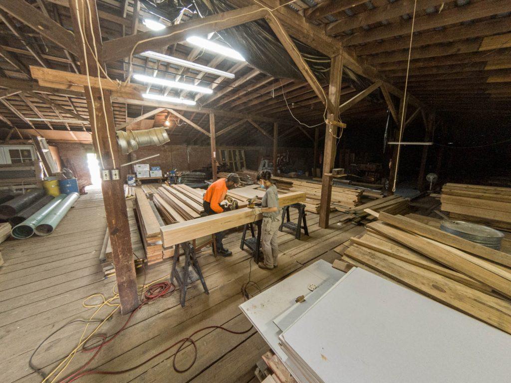 Team sanding wood