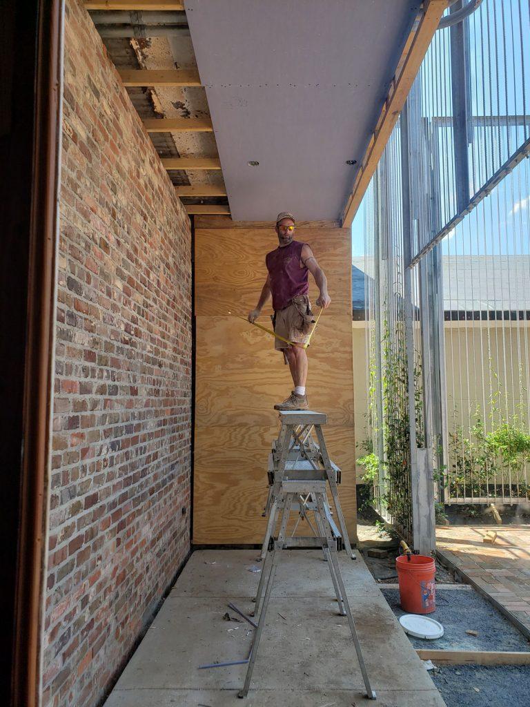 Man intalling drywall