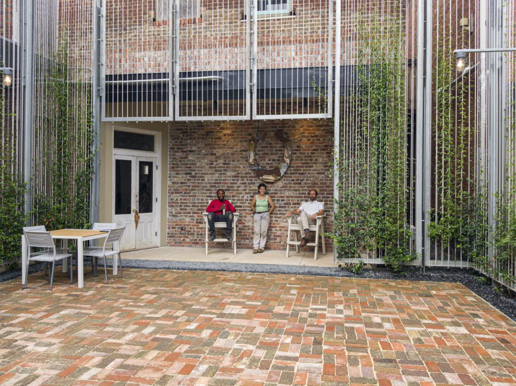 Image of team and client in courtyard