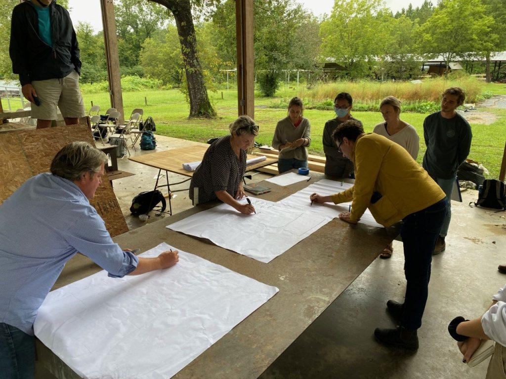 Guests (Kim, Jake, and Joe) drawing diagrams with students