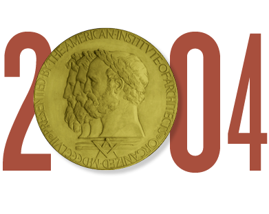 The date 2004 in rust colored type. The first zero in 2004 is represented by a graphic of the AIA Gold Medal