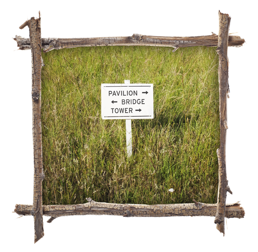 A sign sitting alone in the grass. The sign text gives directions: pavilion with an arrow pointing to the right; bridge with an arrow pointing left; and tower with an arrow pointing right