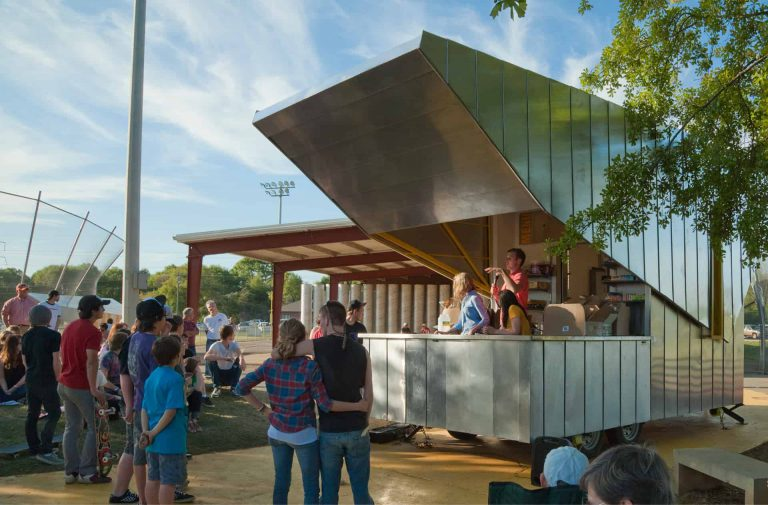A crowd gathers around the Lion's Park concession stand