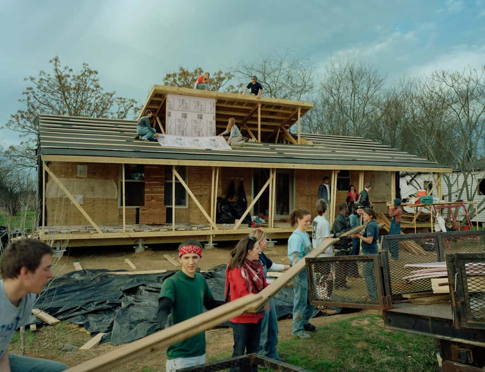 Students working to build the house