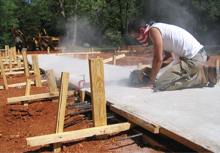 Rural Studio 2004 student working on a foundation