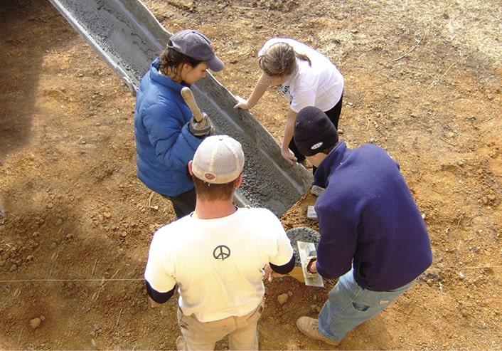 Rural Studio 2009 students pouring concrete