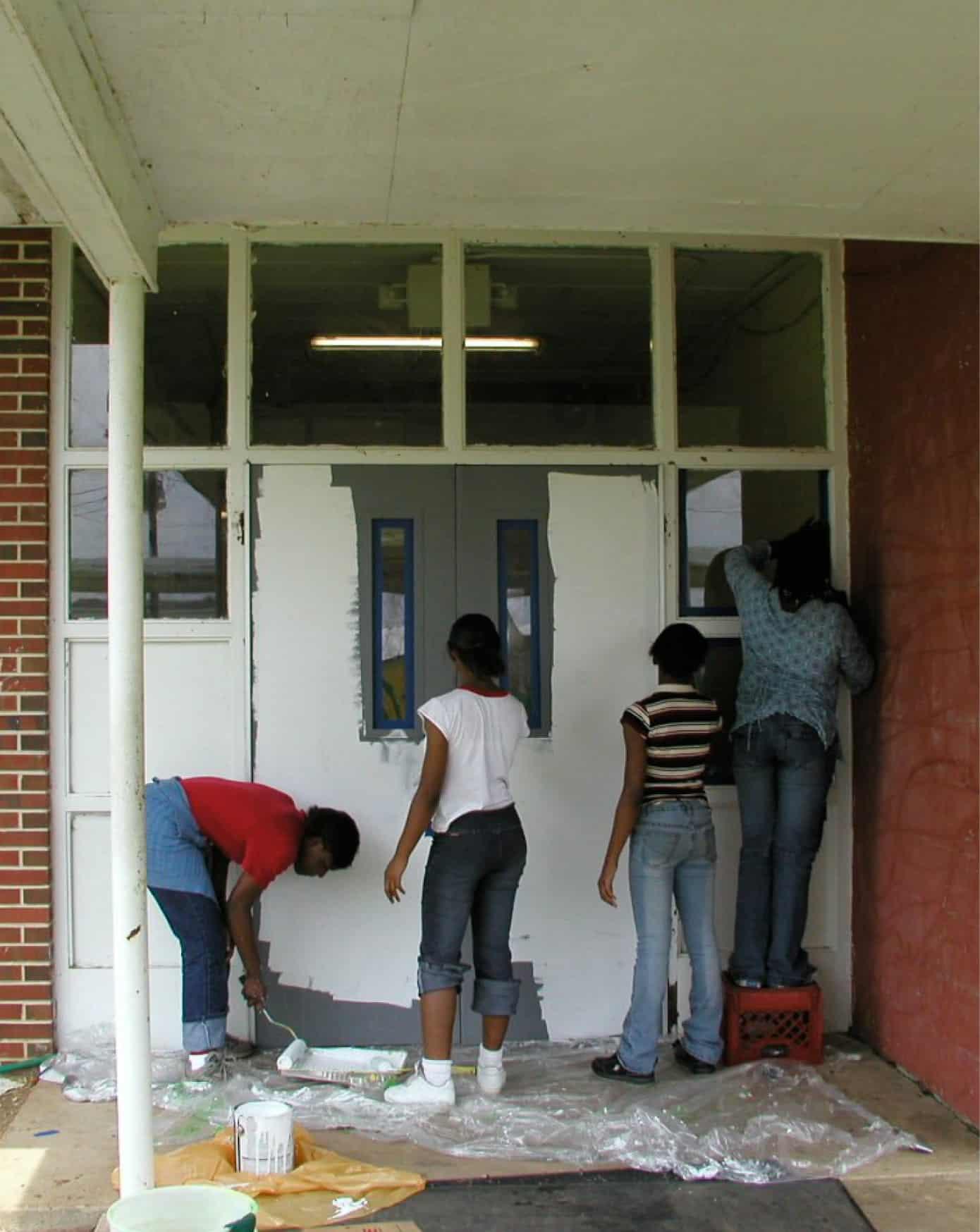 sunshine school students repainting exterior doors