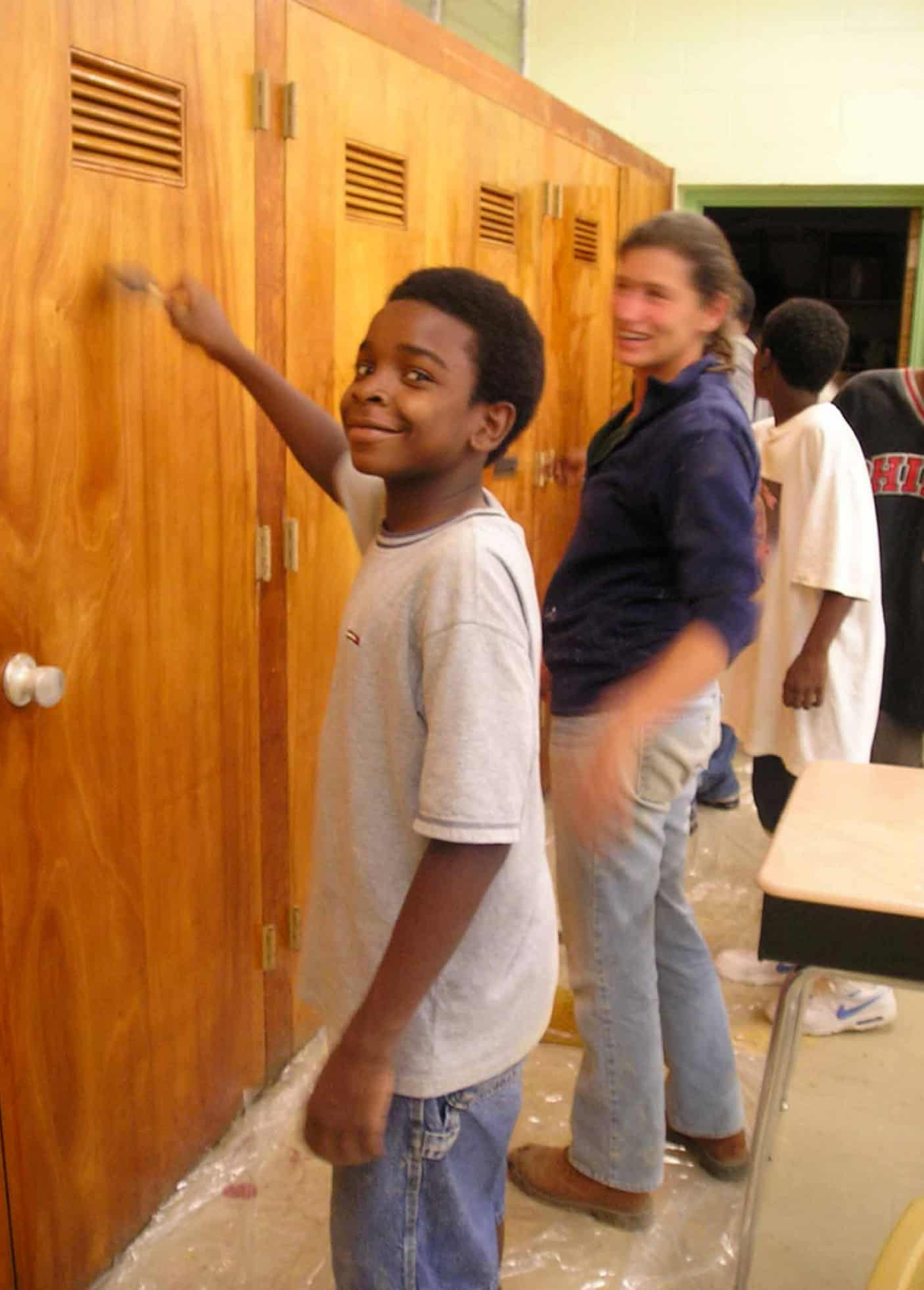 young student and RS student paint lockers together