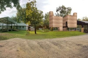 rendering of pods with horizontal timber siding in context of morrisette campus
